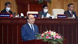 Chủ tịch nước Nguyễn Xuân Phúc: Cùng nhau, Việt Nam-Lào nhất định sẽ phát triển mạnh