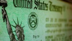 Mỹ: Các khoản hỗ trợ đầu tiên trong gói kích thích kinh tế bắt đầu được chuyển tới người dân