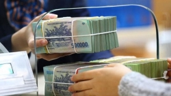 Tiền gửi ngân hàng tăng chậm lại, thanh khoản chưa đáng lo