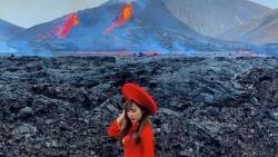 Cô gái Việt đội nón lá, mặc áo dài truyền thống ngắm núi lửa phun trào 6.000 năm mới có ở Iceland